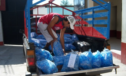 Loading water for Pocohil at the John Wesley School
